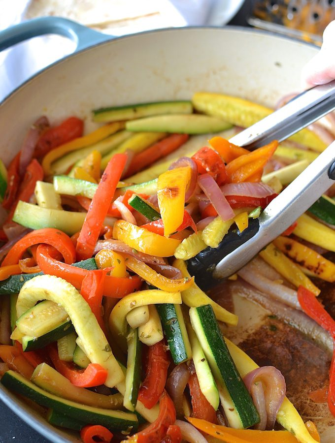 Quick Veggie Fajitas - Fresh and colorful peppers, onions, zucchini and squash are flavored simply and nestled in a warm tortilla in this quick 30-minute dinner recipe. ~sweetpeasandabcs.com