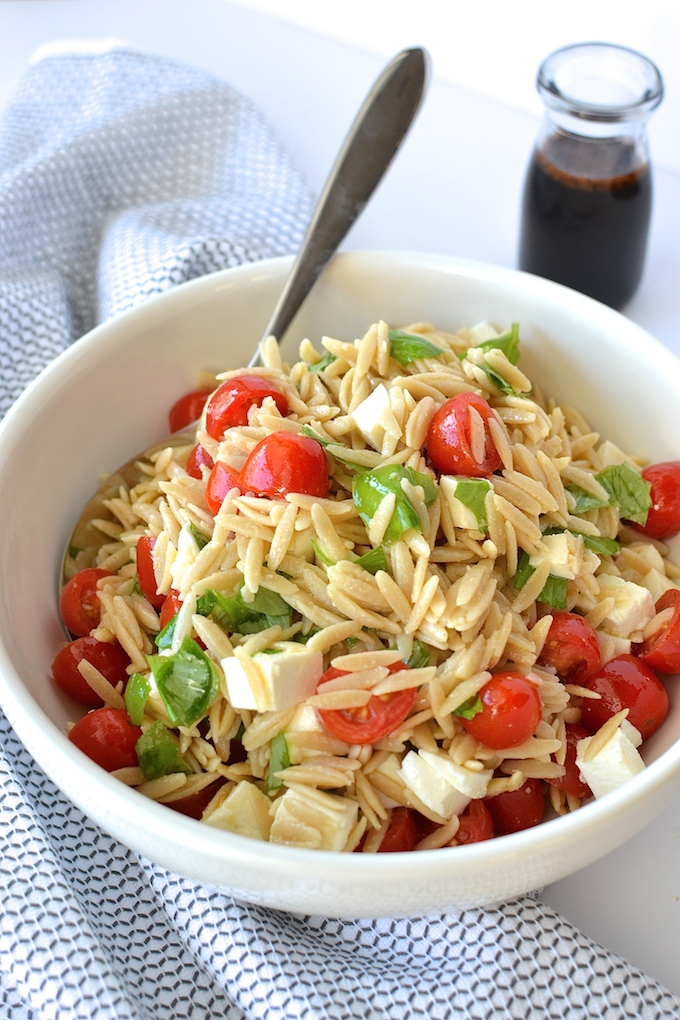 Caprese Orzo Salad with Balsamic Syrup - Fresh mozzarella, juicy tomatoes, garden basil and orzo pasta drizzled with a sweet balsamic syrup...perfect for a weekday lunch or as a side at your summer BBQ! ~sweetpeasandabcs.com