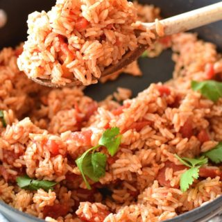 Simple Spanish Rice - Flavored with simple spices and tomatoes, this Simple Spanish Rice recipe is a perfect side dish for any dinner. ~sweetpeasandabcs.com