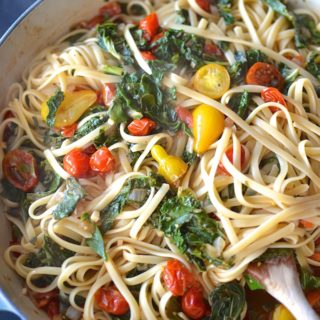 Pasta with Greens and Balsamic Tomatoes - Late summer tomatoes and fall's bountiful greens star in this easy, weeknight pasta dish! ~sweetpeasandabcs.com